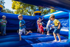 Children Playing Bouncing Castle. Ages two to five six years age at pr school sports day Grace Place Pinetown Durban Royalty Free Stock Image