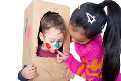 Children playing with a box Stock Image