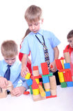 Children playing with bricks Royalty Free Stock Photos