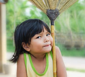 Children playing broom Royalty Free Stock Image