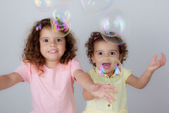 Children playing bubbles Stock Images