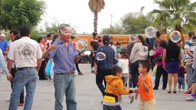 Children playing with bubles in the public squeare. Tepotzotlan, Mexico-CIRCA June 2017: Children playing with bubles in the public squeare. Tourism is one of stock video