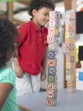 Children Playing With Building Blocks In Class Stock Photos