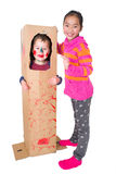 Children playing with cardboard Stock Photo
