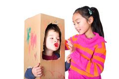Children playing with cardboard and color Stock Image