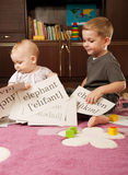 Children playing with cards Stock Images