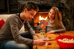 Children playing cards together royalty free stock image