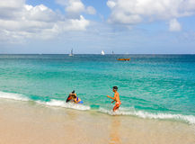Children playing in the caribbean sea Royalty Free Stock Photography