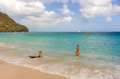 Children playing in the caribbean sea Royalty Free Stock Photo