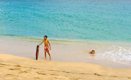Children playing in the caribbean sea Royalty Free Stock Image