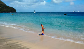 Children playing in the caribbean sea Stock Photo