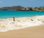 children playing in the caribbean sea Stock Image