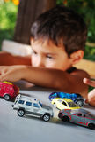 Children playing with cars toys outdoor in summer Royalty Free Stock Photo