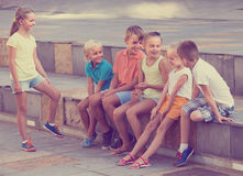 Children playing charades outdoors. Children in school age playing charades outdoors Royalty Free Stock Image