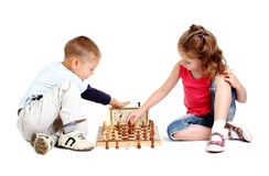Children playing chess Stock Photo