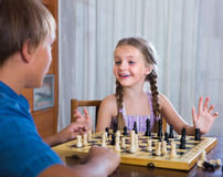 Children playing chess at home Stock Images