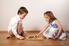 Children playing chess Stock Images