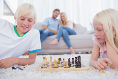 Children playing chess in the living room Stock Image