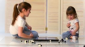 Children playing chess stock video footage
