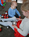 Children playing with Christmas decorations Royalty Free Stock Photography