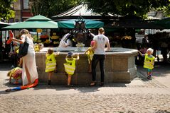 Children playing in a city fountain. Wroclaw, Poland - July 17, 2014: Children playing in a city fountain at Soil square Royalty Free Stock Image