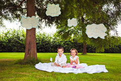 Children playing with clouds in summer park Royalty Free Stock Photography