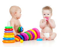 Children playing with color developmental toys Stock Images