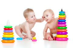 Children playing with color developmental toys Royalty Free Stock Photos