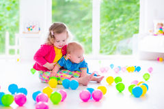 Children playing with colorful toys stock images