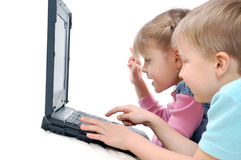 Children playing computer games Stock Images