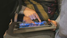 Children playing with computer tablet. Close-up stock video footage