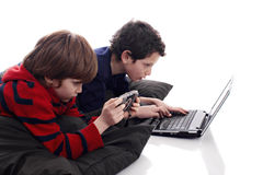 Children playing computer and video games. Isolated on white background Stock Photo