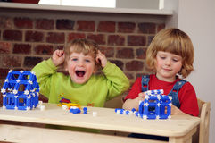 The children are playing with the construction Stock Photography