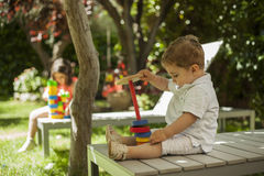 Children playing with construction toys in the garden Royalty Free Stock Photography
