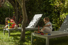 Children playing with construction toys in the garden Stock Image