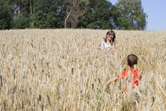 Children playing in the cornfield Stock Photo