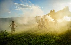 Children playing at countryside in Vietnam. Children playing on dusty grass field at countryside in Central Highlands of Vietnam Royalty Free Stock Photos