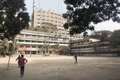 Children playing cricket in Chittagong, Bangladesh stock photo