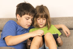 Children playing with a digital tablet Royalty Free Stock Images