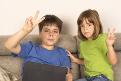 Children playing with a digital tablet Royalty Free Stock Photo