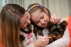 Children playing with dog Royalty Free Stock Photos