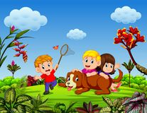 The children are playing with the dog and some of them are catching the butterfly royalty free illustration