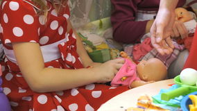Children playing with dolls in kindergarten stock footage