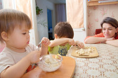 Children playing with dough at home with mummy Stock Photos
