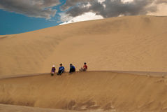 Children playing on the dunes. Stock Images