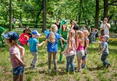 Children playing with entertainer. Zaporizhia/Ukraine- May 28, 2017: Charity Family festival – children playing with entertainer – smiling young woman in a Stock Photo