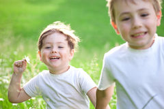Children playing in field Stock Image