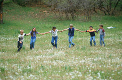 Children playing in field stock images
