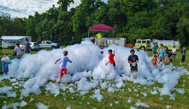 Children Playing in Firemen's Foam stock image