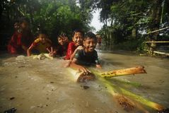 CHILDREN PLAYING AT FLOOD Stock Photo